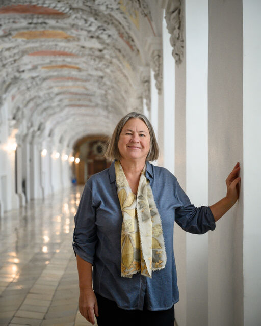 Martina Gebhardt stands in the stucco hall of the monastery Wessobrunn