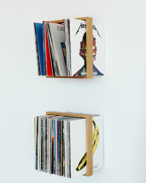 Modern wall shelf with records