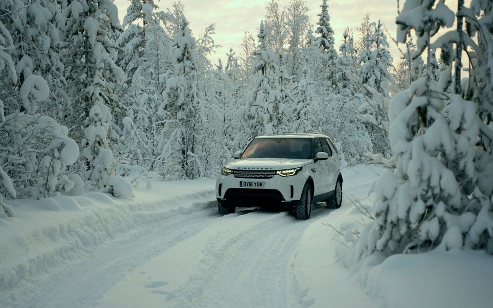 Land Rover Discovery on snow-covered road