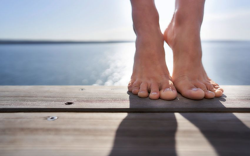 Close-up of a pair of feet on a diving platform at Ammersee